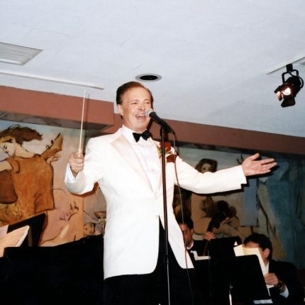 Leading the crowd in song at the Cafe Carlyle, NYC