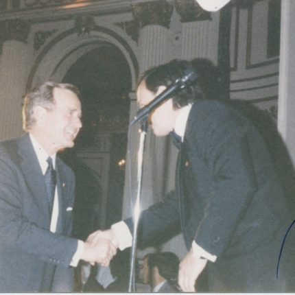 Alex greeting former President George H.W. Bush at the Plaza Hotel